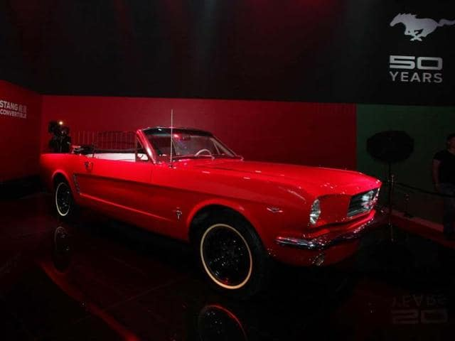 A-1965-Ford-Mustang-Convertible-car-on-display-at-the-50-years-celebration-ceremony-of-Ford-Mustang-in-Beijing-on-April-19-2014-ahead-of-the-Auto-China-2014-Beijing-International-Automotive-Exhibition-Ford-Motor-launched-its-luxury-Lincoln-car-brand-in-China-on-April-17-just-days-ahead-of-Beijing-s-auto-show-in-the-world-s-largest-car-market-Photo-AFP