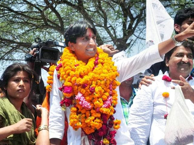 AAP-candidate-from-Amethi-Kumar-Vishwas-waves-to-supporters-during-his-road-show-at-Gauriganj-in-Amethi-PTI-Photo