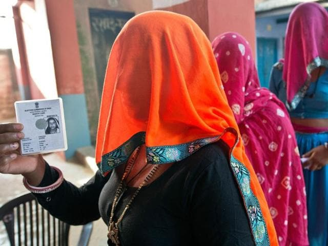 Women voter queue to cast their votes at Gailpuri booth in Alwar, Rajasthan. (AFP photo)