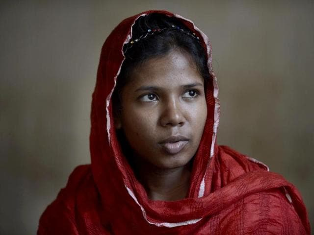 A-photo-of-Bangladeshi-garment-worker-Reshma-Akhter-who-was-rescued-after-17-days-from-the-rubble-of-the-collapsed-Rana-Plaza-building-in-Bangladesh-AFP-photo