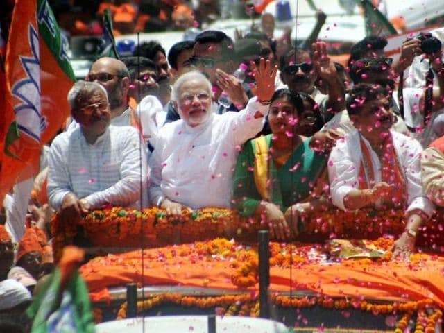 BJP-prime-ministerial-candidate-Narendra-Modi-waves-at-supporters-during-a-road-show-before-filing-his-nomination-papers-in-Varanasi-PTI-photo