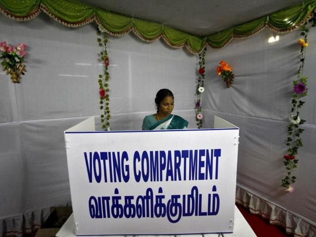 A woman casts her vote at a polling station in Chennai. (Reuters)