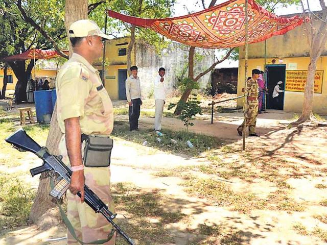 Two-voters-wait-their-turn-to-cast-vote-at-a-polling-booth-in-Bharatpur-district-HT-Photo