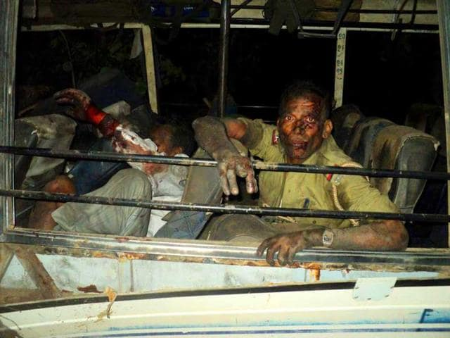 A-cop-reacts-after-a-suspected-Maoist-rebel-attack-on-a-convoy-of-election-officials-at-Sikaripara-in-Dumka-district-Ranchi-AFP-photo
