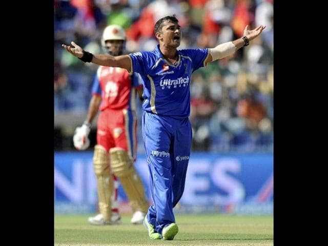 Rajasthan-Royals-bowler-Pravin-Tambe-celebrates-after-dismissing-Sunrisers-Hyderabad-s-David-Warner-during-their-IPL-7-match-in-Ahmedabad-Vijayanand-Gupta-HT-Photo