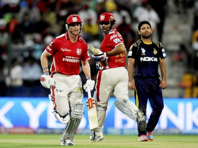 Virender Sehwag and George Bailey of Kings X1 Punjab run between the wickets against Kolkata Knight Riders during their IPL7 match in Abu Dhabi. (PTI Photo)