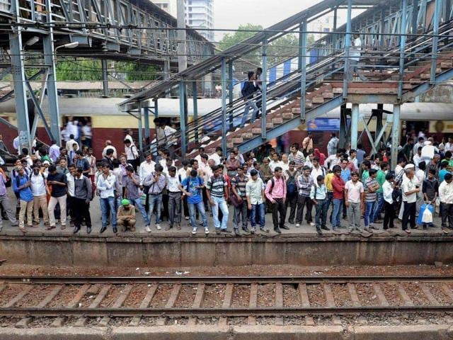 Commuters-crowd-onto-a-platform-as-they-wait-for-a-train-at-a-station-on-the-suburban-train-network-in-Mumbai-AFP-photo