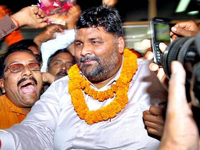 Supporters welcome RJD leader Pappu Yadav at Patna airport. (PTI photo)