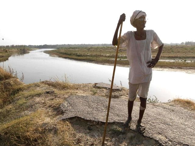 A-road-was-cut-because-of-floods-in-Gomati-in-2008-severing-the-connectivity-between-four-villages-People-claim-they-have-approached-everyone-in-administration-but-got-no-relief-They-have-declared-to-boycott-the-Lok-Sabha-polls-in-protest-Virendra-Singh-Gosain-HT-Photo