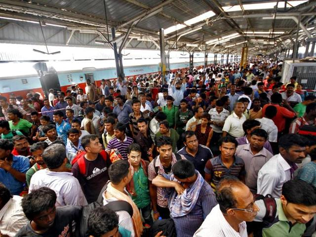 People crowd at a railway station to get the glimpse of a passenger train in which two explosions occurred, in Chennai. (Reuters photo)