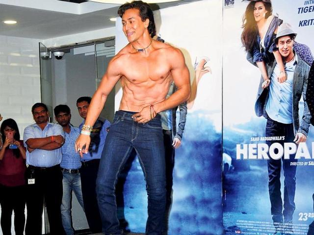 Tiger-Shroff-poses-with-a-flute-at-a-film-event-We-wonder-if-the-actor-can-play-the-instrument-as-well