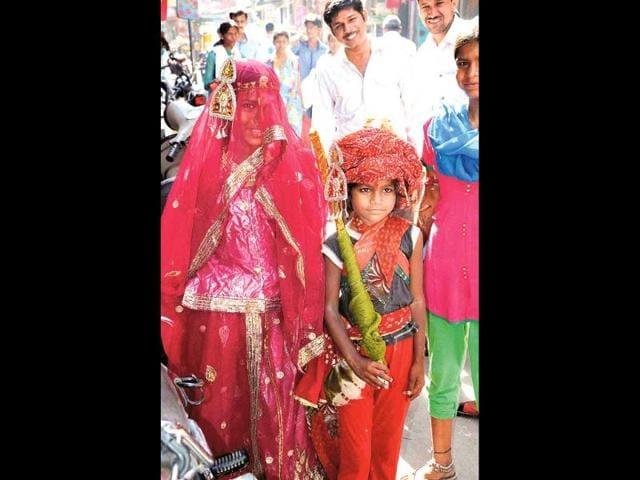 Little-girls-dress-up-as-bride-and-groom-on-the-Akha-Teej-day-Ramji-Vyas-HT-Photo
