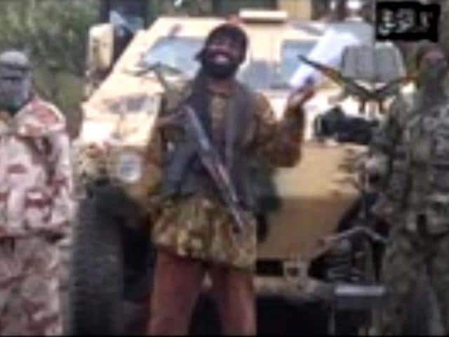 Leader-of-the-Islamist-extremist-group-Boko-Haram-Abubakar-Shekau-C-delivers-a-speech-Shekau-vowed-to-sell-hundreds-of-schoolgirls-kidnapped-in-northern-Nigeria-three-weeks-ago-AFP-Photo