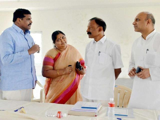Congress Seemandhra leaders Pallam Raju (R) with other leaders in Hyderabad. (PTI Photo)