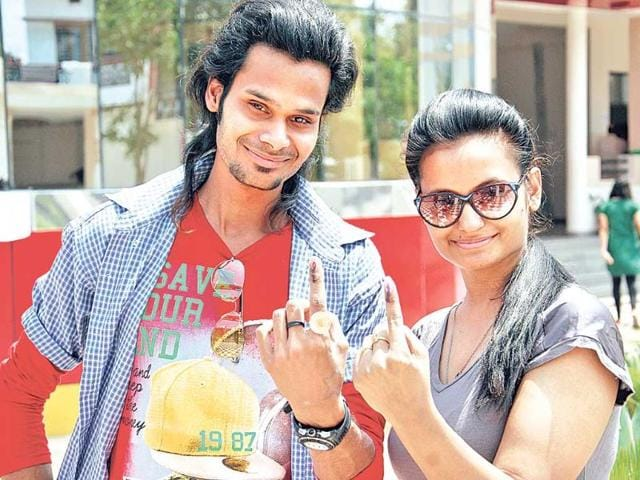 Youngsters-show-their-inked-finger-after-casting-their-vote-at-a-polling-booth-in-Dehradun-Vinay-Santosh-Kumar-HT-Photo