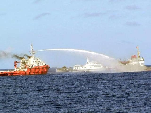 Chinese-vessels-L-use-water-cannons-on-Vietnamese-vessels-R-near-the-Paracel-islands-EPA-photo