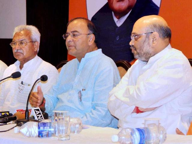 BJP-leader-Arun-Jaitley-with-party-leaders-Amit-Shah-and-Laxmikant-Bajpai-addresses-a-press-conference-in-Varanasi-PTI-photo