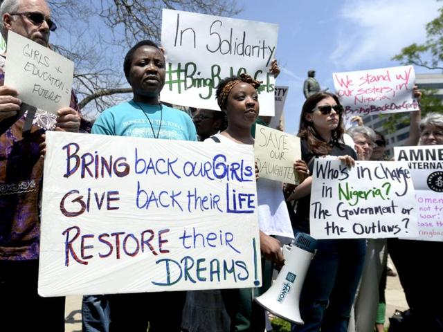 People-attend-a-vigil-in-support-and-solidarity-with-the-abducted-girls-of-the-Government-Girls-School-in-Chibok-Nigeria-at-Farragut-Square-in-Washington-DC-USA-EPA-Photo