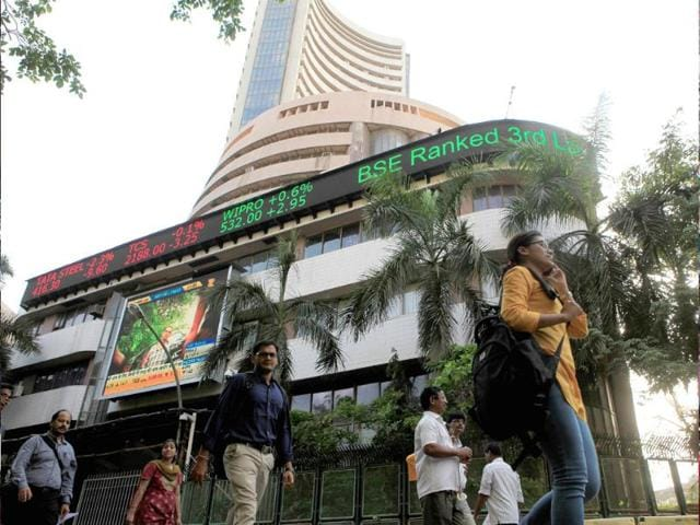 People-walk-past-a-billboard-outside-Bombay-Stock-Exchange-HT-Photo-Anshuman-Poyrekar