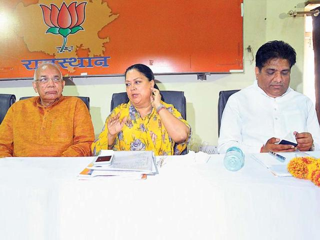 L-R-BJP-leader-Kaptan-Singh-Solanki-CM-Vasundhara-Raje-and-senior-leader-Bhupender-Yadav-during-a-feedback-meeting-at-the-party-office-in-Jaipur-on-Saturday-HT-Photo