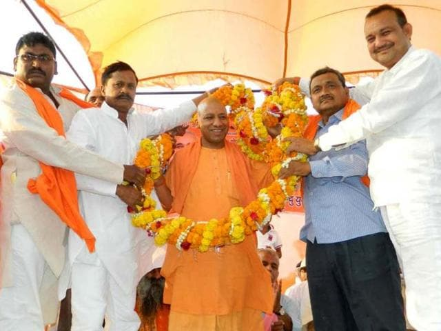 BJP MP Yogi Adityanath being welcomed by party workers during a public meeting in Gorakhpur. (Photo/Hindustan Times)