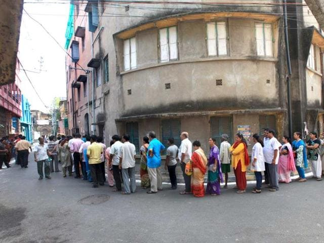 Voters wait in line to cast their votes at a polling station during the ninth and final phase of the parliamentary elections in Kolkata. (EPA Photo)