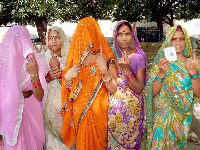 Village women show their inked fingers after casting votes for the last phase of Lok Sabha elections in Mirzapur. (PTI Photo)