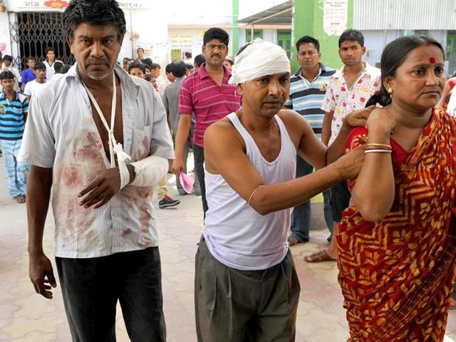 Two injured are brought to the Haroa block hospital with bullet injuries during the political clash at Haroa of Basirhat constituency, North 24 Parganas, West Bengal. (Subhendu Ghosh/HT Photo)