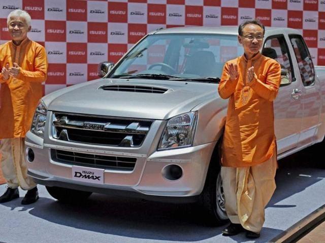 Shigeru-Wakabayashi-Deputy-Managing-Director-Isuzu-Motors-India-and-Takashi-Kikuchi-Managing-Director-of-Isuzu-Motors-India-during-the-launch-of-Isuzu-D-Max-pick-up-trucks-in-Mumbai-on-Tuesday-Photo-PTI