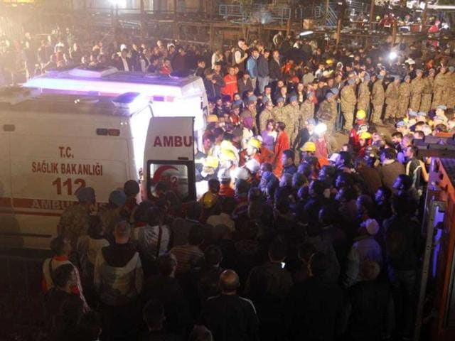 Body of a miner carried to an ambulance in Soma, a district in Turkey