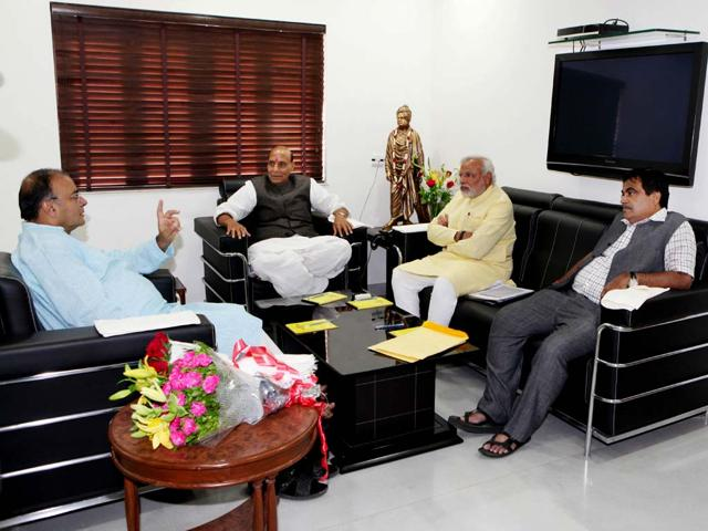 This-handout-photograph-from-the-the-BJP-Media-Cell-Gujarat-shows-Arun-Jaitley-Rajnath-Singh-Narendra-Modi-and-Nitin-Gadkari-during-a-meeting-at-Modi-s-residence-in-Gandhinagar-AFP-Bhartiya-Janta-Party-Media-Cell-Gujarat