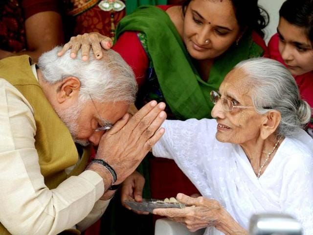 BJP-prime-ministerial-candidate-Narendra-Modi-C-greets-well-wishers-at-the-home-of-his-mother-Hira-Ba-in-Gandhinagar-AFP-Photo