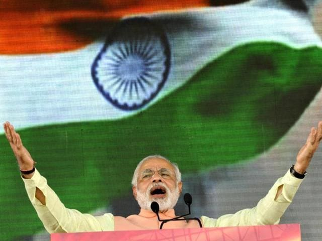 India-s-Prime-Minister-Narendra-Modi-waves-after-delivering-a-speech-from-the-ramparts-of-the-Red-Fort-in-New-Delhi-on-August-15-2014-to-mark-the-country-s-68th-Independence-Day-AFP-Photo