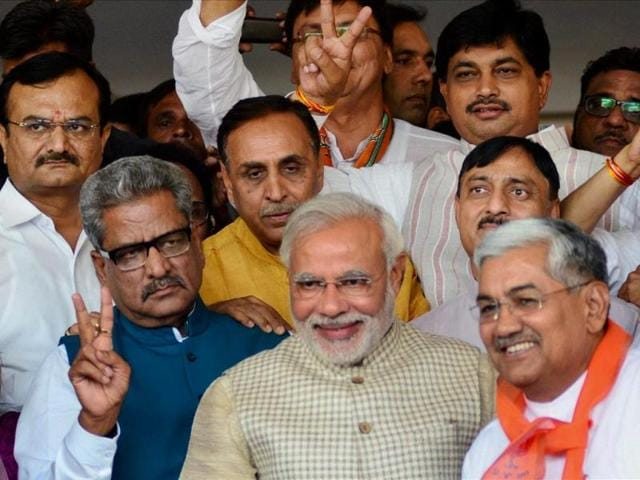 Narendra Modi with other BJP leaders at the party office in Gandhinagar. (PTI)