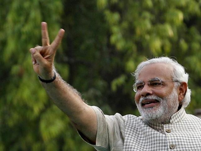 Narendra Modi flashes the victory sign as he arrives at a public rally after his victory in Vadodara. BJP registered a massive victory in the 16th Lok Sabha elections. (AFP Photo)