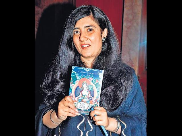 Charu-Singh-holds-up-a-copy-of-her-debut-book-Path-of-the-Swan-HT-Photo