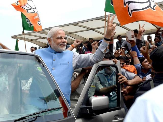 BJP-s-Narendra-Modi-gestures-from-his-car-during-a-road-show-upon-his-arrival-at-the-airport-in-New-Delhi-Reuters-Photo