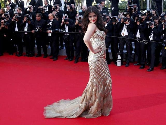 Aishwarya Rai Bachchan has had her share of brickbats for her past style statements on the Cannes red carpet. But the former Miss World nailed it this time as she sashayed down one of the most watched red carpets in the world in a gold strapless Roberto Cavalli evening gown.