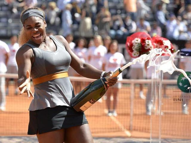 Serena-Williams-sprays-champagne-as-she-celebrates-after-beating-Italian-Sara-Errani-in-the-WTA-Rome-s-Tennis-Masters-final-AFP-Photo