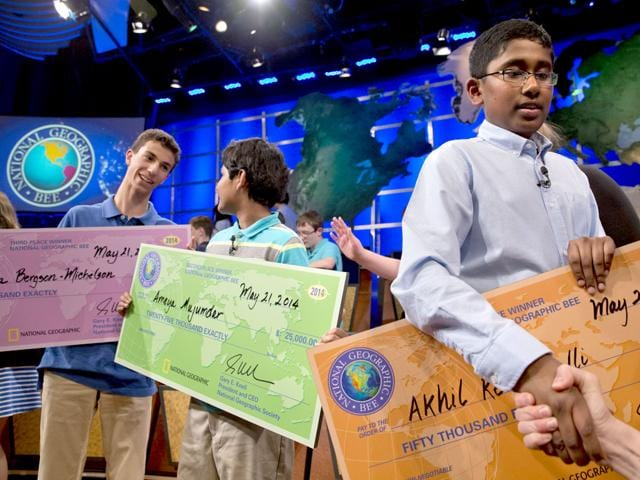 Third-place-winner-Tuvya-Bergson-Michelson-of-Hillsborough-Calif-left-second-place-winner-Ameya-Mujumdar-of-Tampa-Fla-and-first-place-winner-Akhil-Rekulapelli-of-Sterling-Va-hold-their-awards-after-competing-in-the-finals-of-the-National-Geographic-Bee-at-the-National-Geographic-Society-in-Washington-AP-Photo
