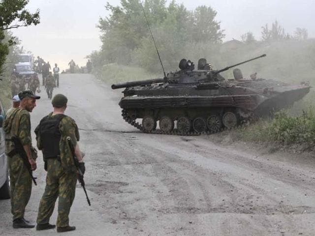 A-pro-Russian-separatist-in-the-eastern-Ukrainian-town-of-Slaviansk-Reuters-photo