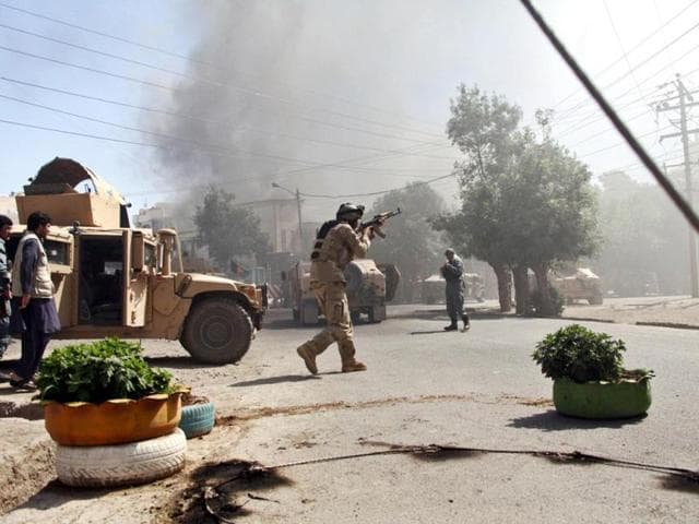 An Afghan special forces soldier, aims his weapon at the site of a clash between insurgents and security forces on the Indian Consulate in Herat. (AP Photo)