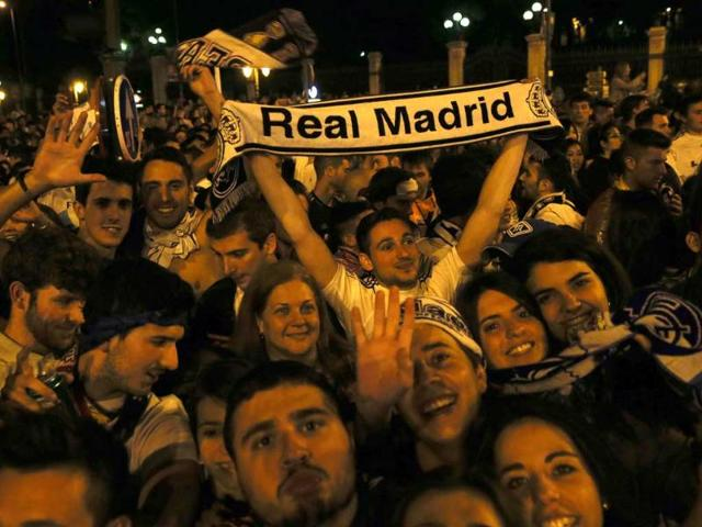 Real-Madrid-supporters-celebrate-their-victory-after-their-Champions-League-final-against-Atletico-Madrid-at-the-Cibeles-Square-in-Madrid-Reuters-Photo
