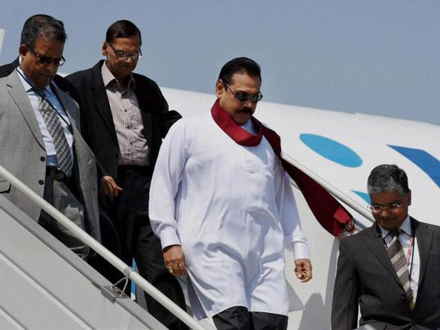 Sri Lankan President Mahinda Rajapaksa arrives at AFS Palam to attend the swearing-in ceremony of Narendra Modi as Prime Minister, in New Delhi on Monday. (PTI photo)