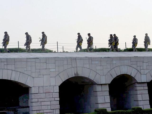 Security personnel keep vigil at Rajghat during the visit by Narendra Modi in New Delhi on Monday. (PTI photo)