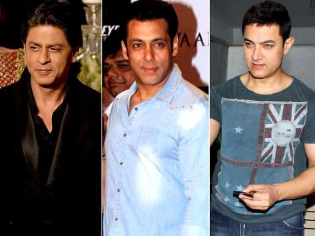 Three-s-company-four-is-actually-fun-Actor-Aamir-Khan-Salman-Khan-and-Shah-Rukh-Khan-during-a-programme-organised-to-celebrate-21-years-of-a-TV-show-at-Pragati-Maidan-in-New-Delhi-on-Dec-2-2014-IANS