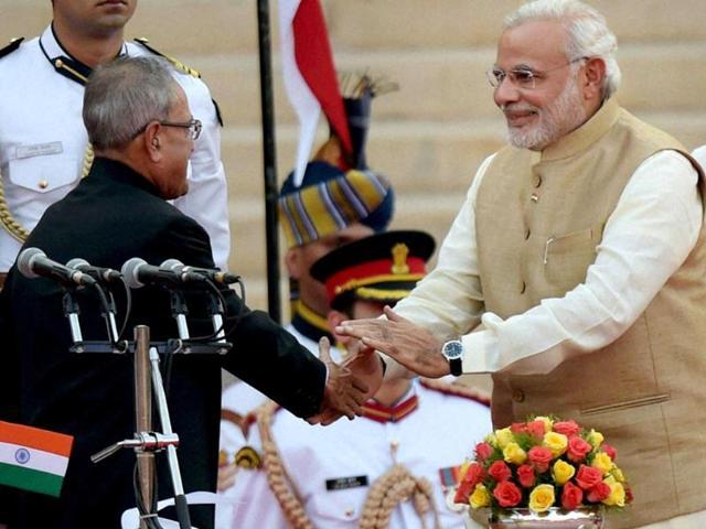 President-Pranab-Mukherjee-arrives-with-Prime-Minister-Narendra-Modi-Vice-President-Hamid-Ansari-and-Lok-Sabha-Speaker-Sumitra-Mahajan-to-address-the-joint-session-of-Parliament-in-New-Delhi-HT-Photo-Ajay-Aggarwal
