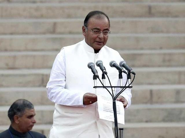 Arun-Jaitley-is-administered-oath-of-office-by-President-Pranab-Mukherjee-unseen-as-a-Cabinet-minister-at-the-presidential-palace-in-New-Delhi-Reuters