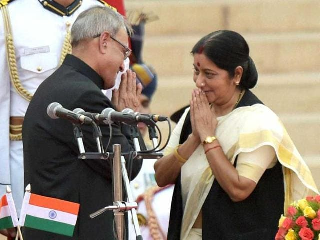 President Pranab Mukherjee greets newly sworn-in minister Sushma Swaraj after administering her the oath at a ceremony at Rashtrapati Bhavan in New Delhi . (PTI Photo)