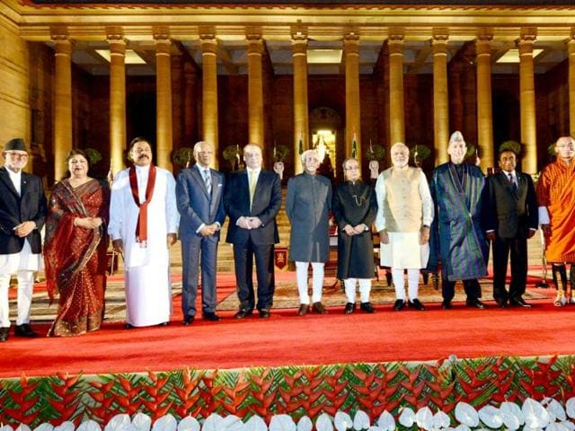 A-handout-photograph-shows-PM-Narendra-Modi-4-R-along-with-President-Pranab-Mukherjee-5-R-and-VP-Hamid-Ansari-C-with-invited-foreign-dignitaries-at-the-Rashtrapati-Bhawan-in-New-Delhi-EPA-Photo